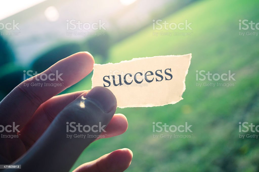 Success written on torn paper held in hand royalty-free stock photo