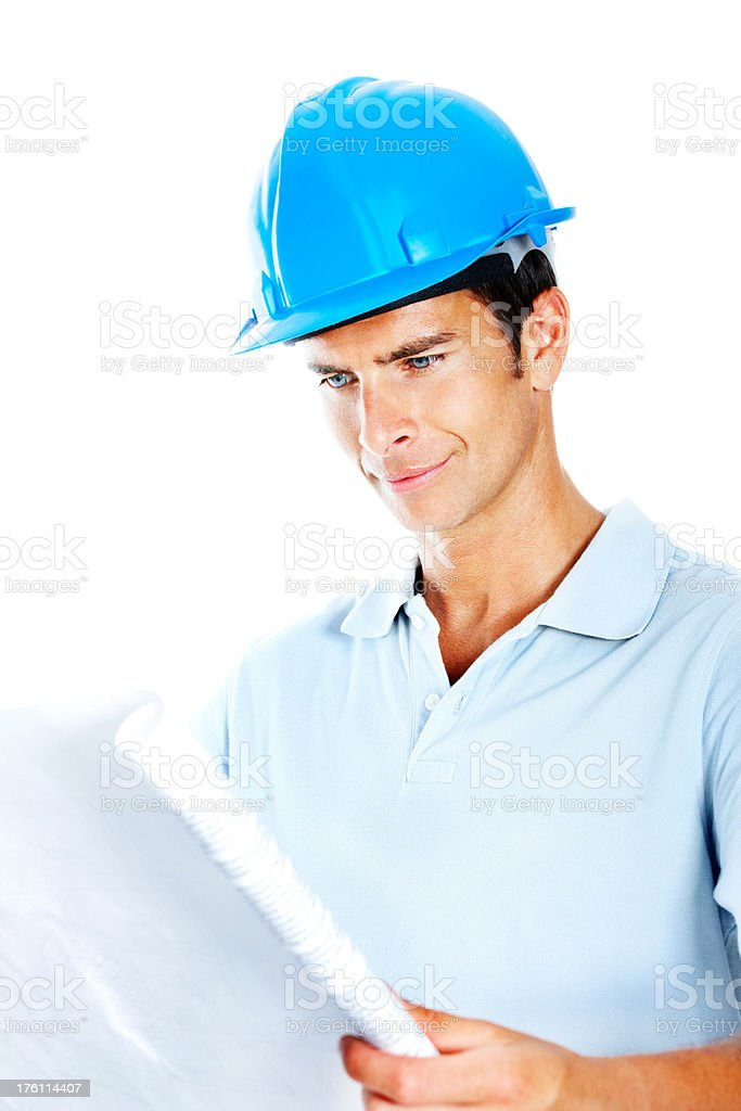 Successful achitect going through blue prints royalty-free stock photo