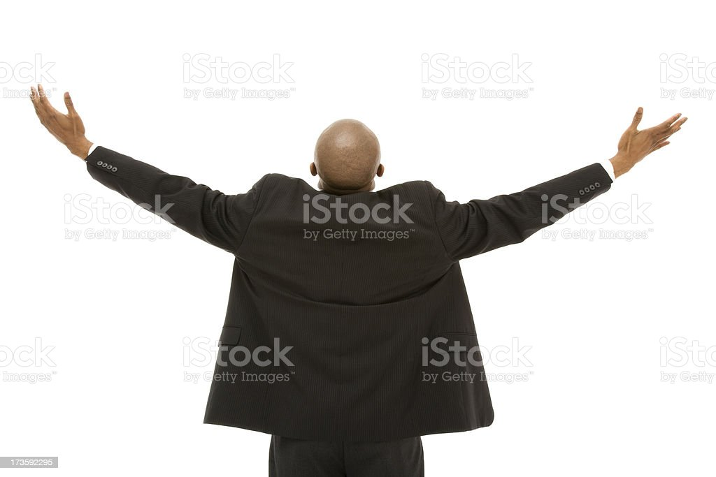 Successful African American business man from behind arms raised isolated stock photo