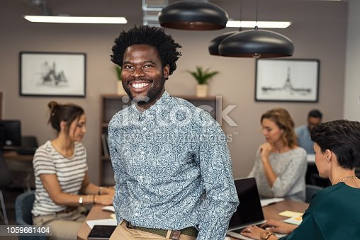 istock Successful african business man smiling 1059661404