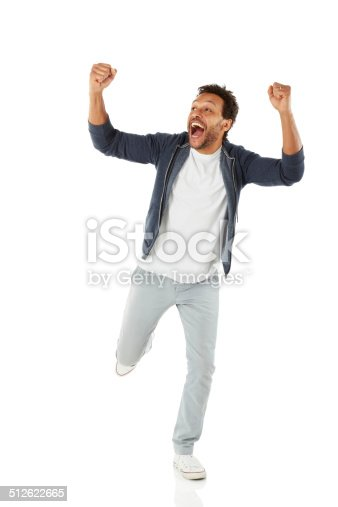 istock Successful african man celebrating his achievement 512622665