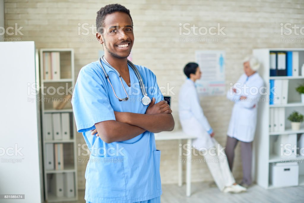 Successful African surgeon in doctors office stock photo