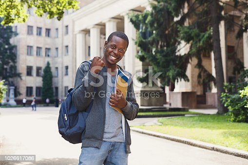 istock Successful african-american student with books in university campus 1026617086