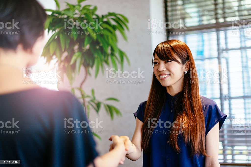 Successful agreement in Japanese businessman stock photo