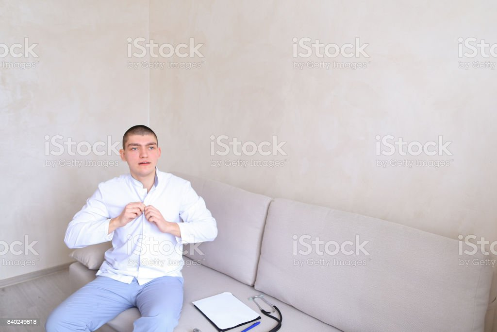 Successful and confident doctor prepares for working day and rec stock photo