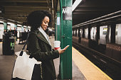istock Successful and elegant woman walks the streets of New York 1203839147