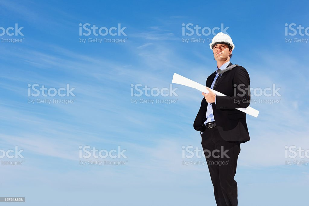 Successful architect holding a blueprint with copy space royalty-free stock photo