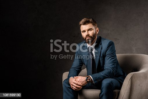 istock successful bearded businessman sitting in armchair 1081599130