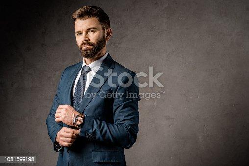 1081599130 istock photo successful bearded businessman standing in formalwear 1081599198