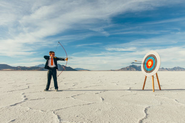 Successful Business Boy with Arrows in Target stock photo