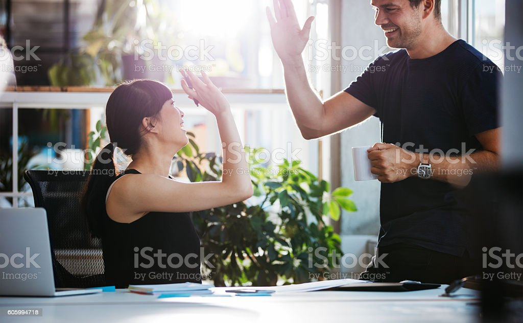 Successful business colleagues giving high five - foto stock