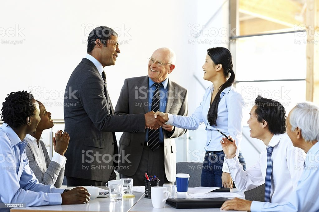 Successful business colleagues shaking hands with each other royalty-free stock photo