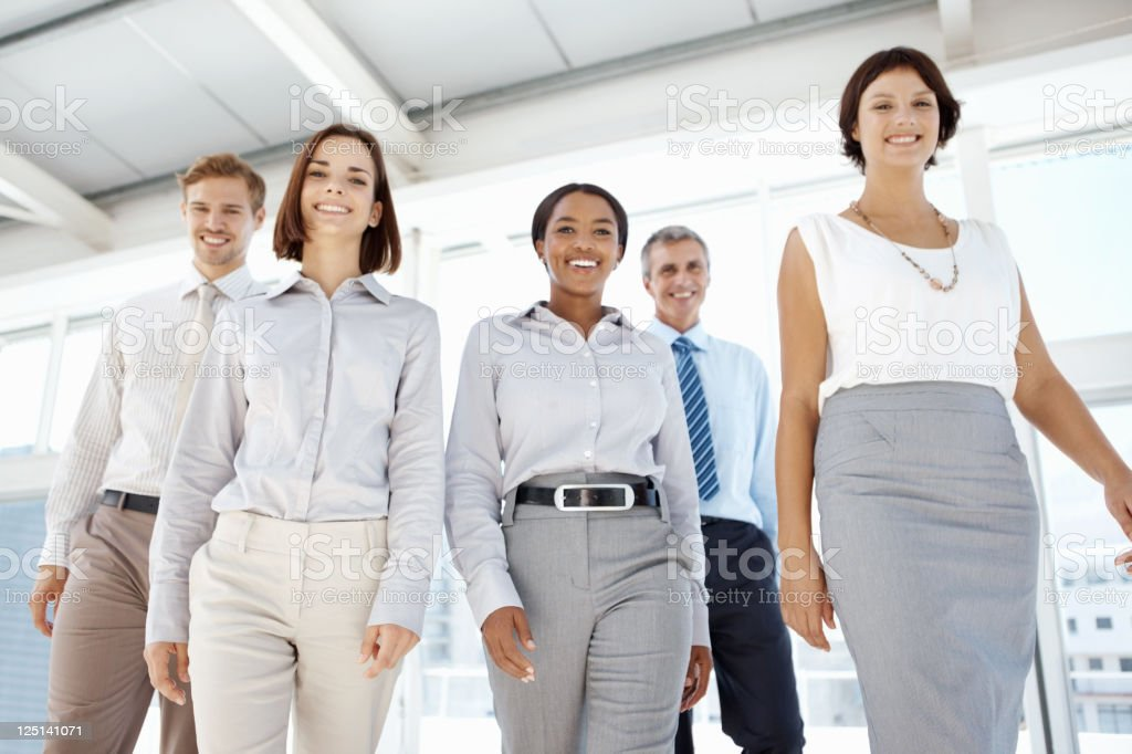 Successful business colleagues walking towards to you royalty-free stock photo