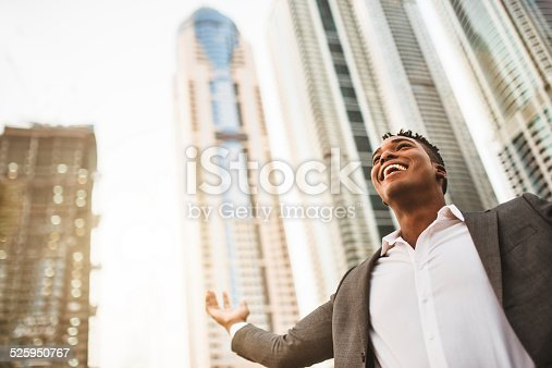 istock Successful business man against the skyscraper 525950767