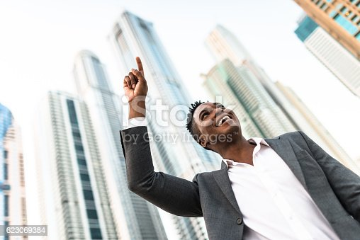 istock Successful business man against the skyscraper 623069384