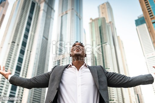 istock Successful business man against the skyscraper 623069662
