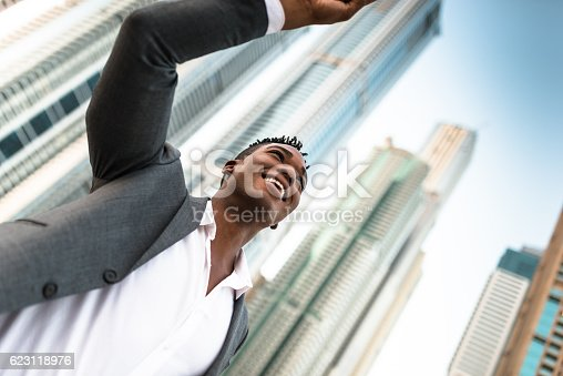 istock Successful business man against the skyscraper 623118976