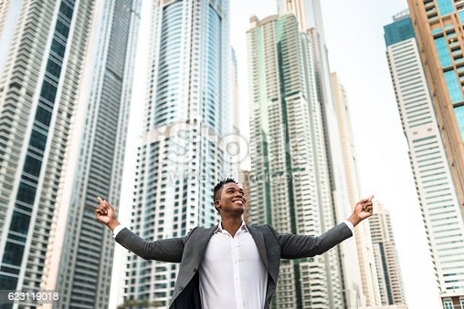 istock Successful business man against the skyscraper 623119018