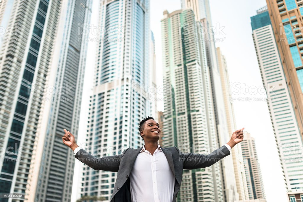 Successful business man against the skyscraper stock photo