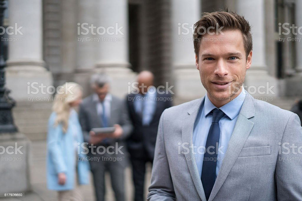 Successful business man leading a group – Foto