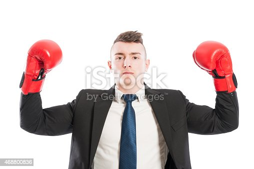 464164875 istock photo Successful business man lifting arms up as a champion 468800836