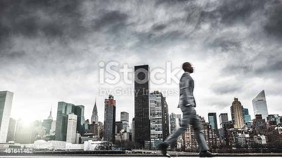 istock Successful business man looking away against the skyline 491641462