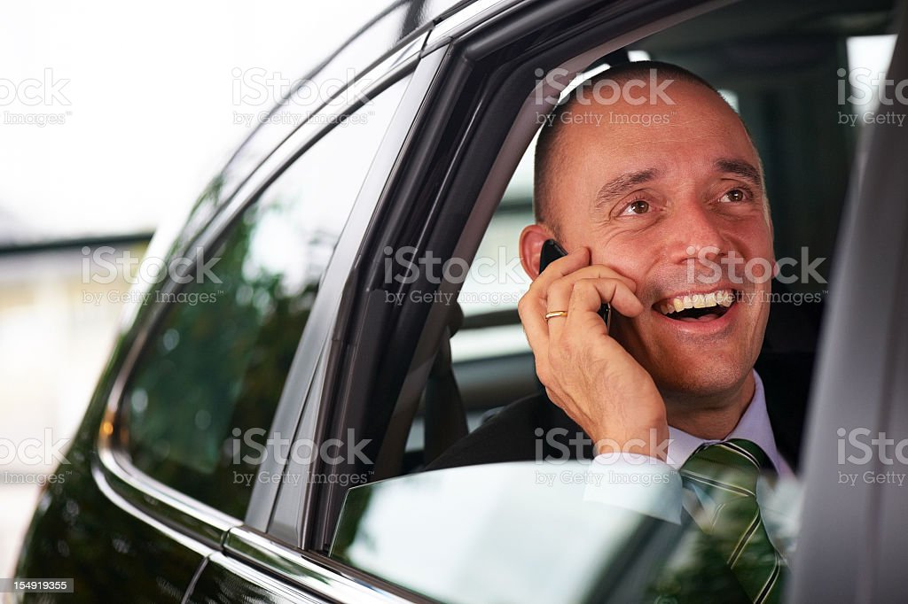 Successful business man on mobilephone in car royalty-free stock photo