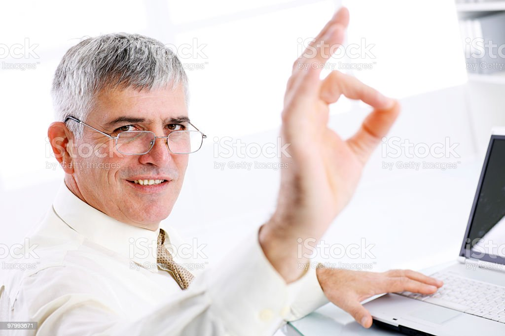 Successful business man showing ok. royalty-free stock photo