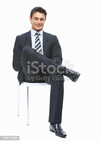 Full length of young business man sitting on office chair