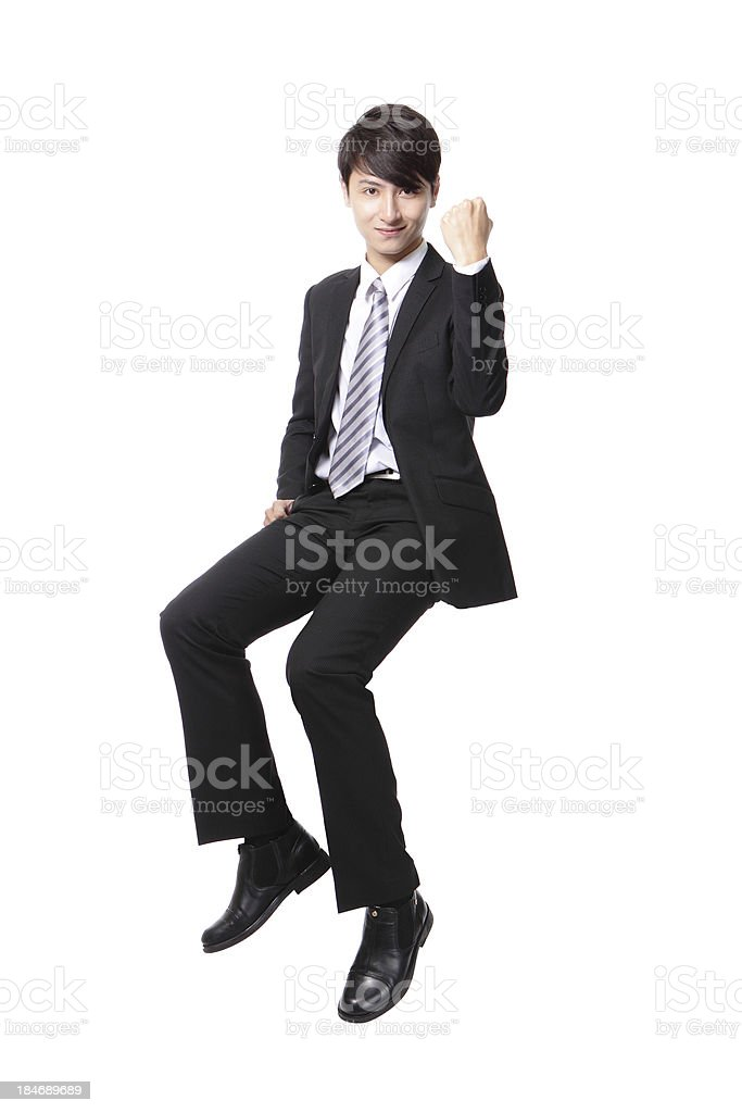 Successful business man sitting on something royalty-free stock photo