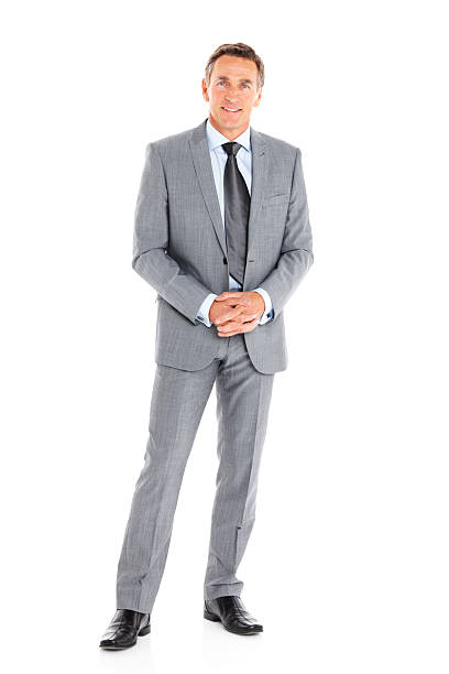 Successful business man standing on white stock photo