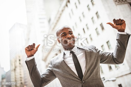 istock Successful business man with thumbs up 519937231
