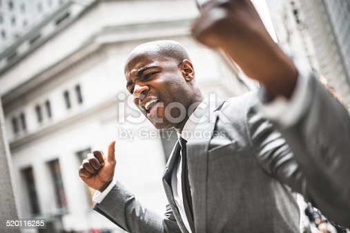 istock Successful business man with thumbs up 520116285
