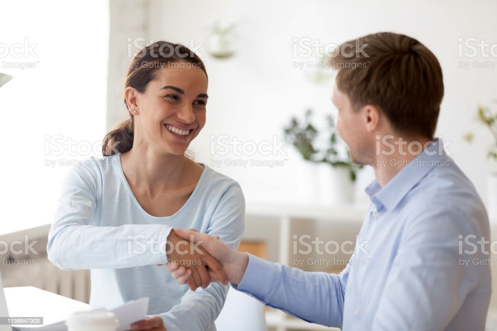 Successful business negotiations with handshake between two partners....