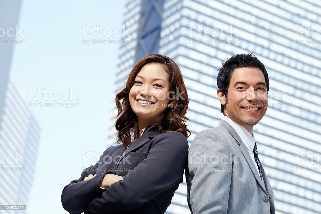 Successful business partners in front of modern office building royalty-free stock photo