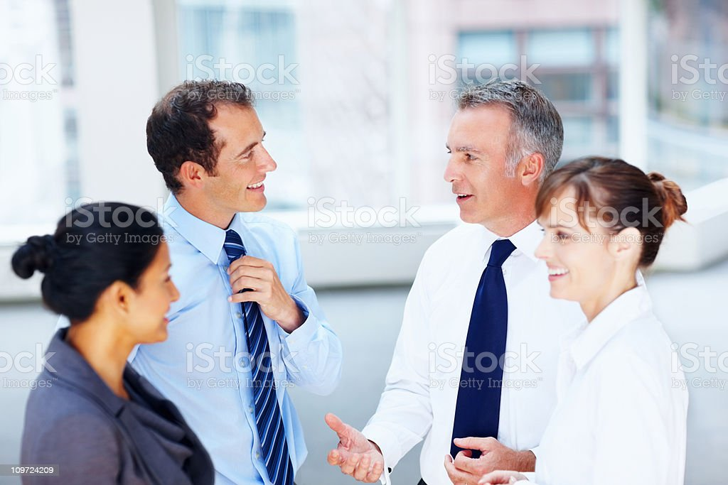 Successful business people discussing with each other royalty-free stock photo