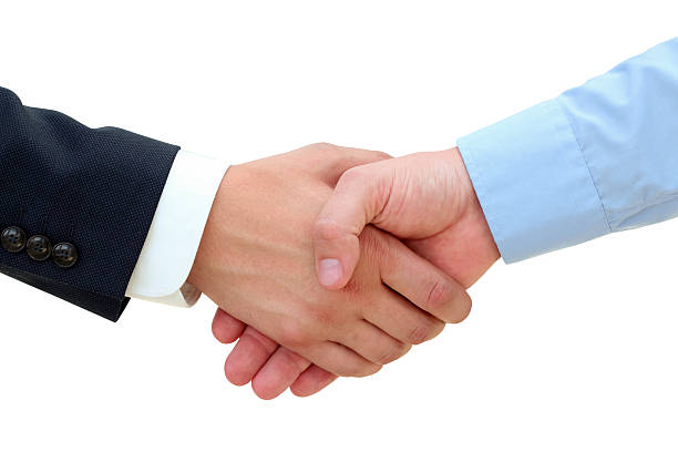 Successful business people shaking hands on a white background – Foto