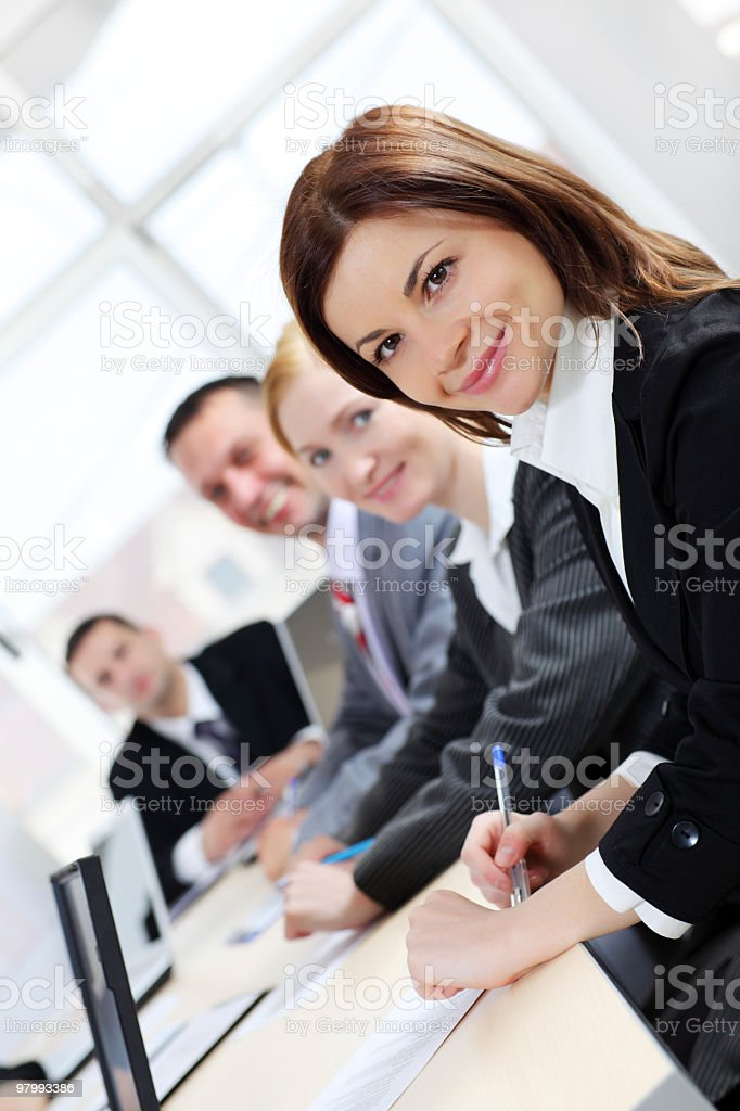 Successful business people sitting in the office. royalty-free stock photo