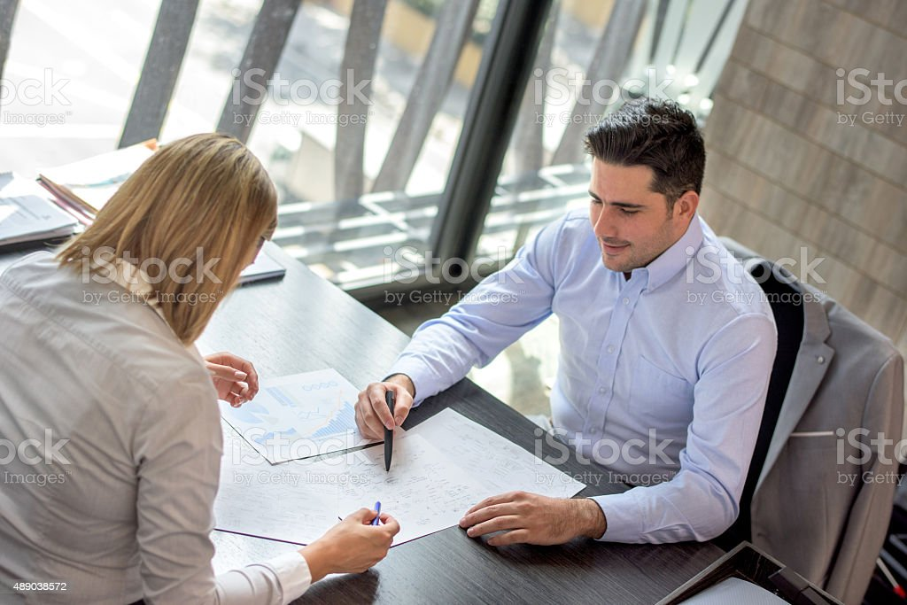Successful business people working at the office stock photo