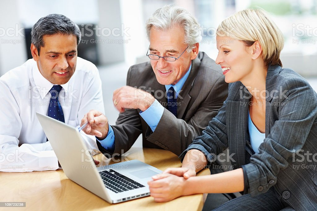 Successful business people working on a laptop at meeting royalty-free stock photo