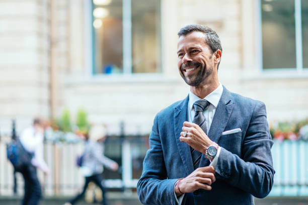 Successful business person expressing positive emotion Portrait of politician - mature man in full suit with necktie in London, United Kingdom. upper class stock pictures, royalty-free photos & images