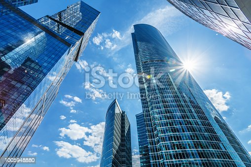 Modern business buildings under clear blue sky