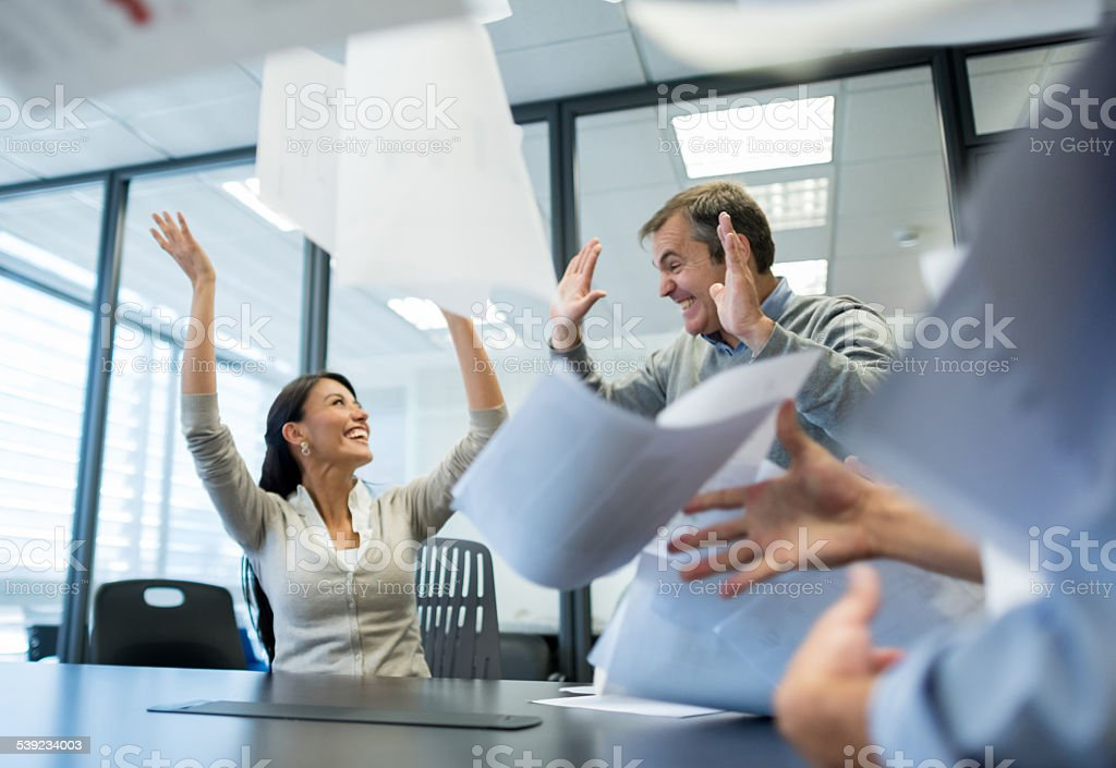 Successful business team celebrating in a meeting royalty-free stock photo