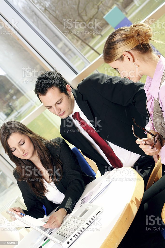 successful business team is working on a laptop royalty-free stock photo