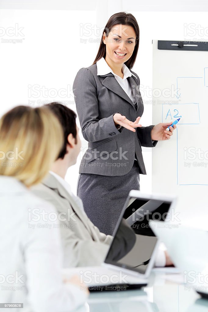 Successful business woman giving a presentation on flipchart. royalty-free stock photo