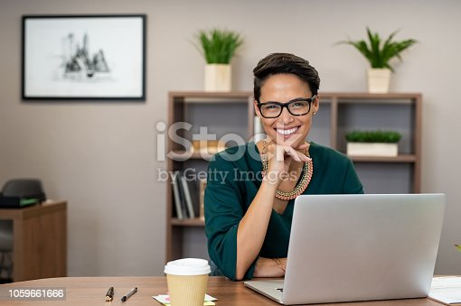 istock Successful business woman smiling 1059661666