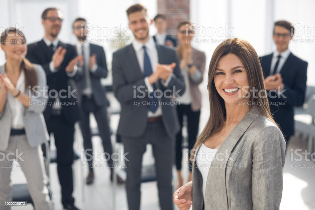 successful business woman standing in conference room stock photo