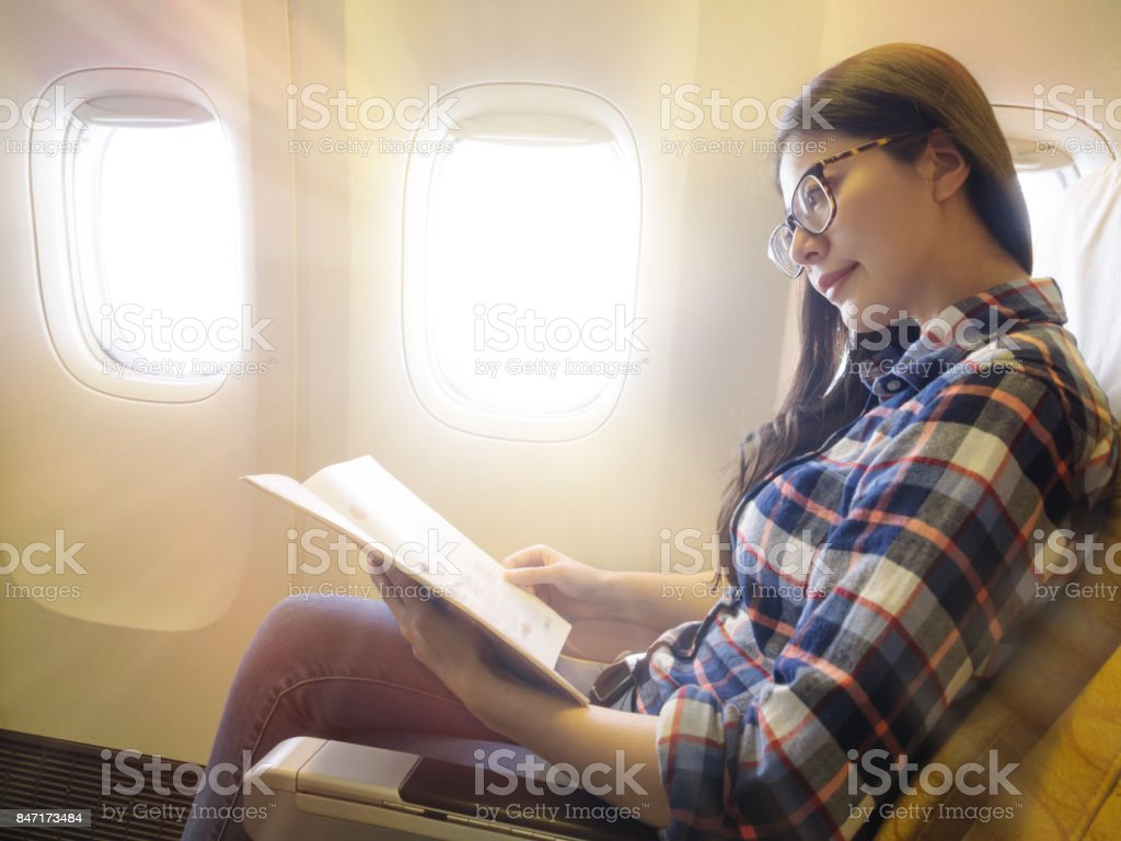 successful business woman taking the airplane stock photo