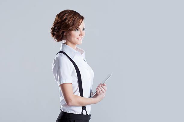 Exitosa mujer de negocios con computadora portátil en la mano, lugar para texto - foto de stock