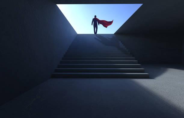 empresário de sucesso subir na escada - capuz - fotografias e filmes do acervo